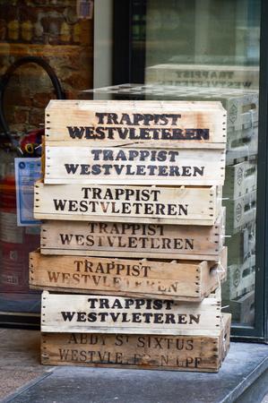 Brussels, Belgium - April 2015: Empty wooden crate of Belgian beer in front of liquor store in Brussels, Belgium