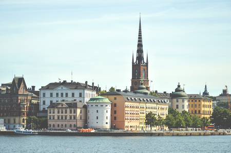 Cityscape view of Stockholm old town in famous Gamla Stan area densely situated by archaic buildings influenced by North German architecture