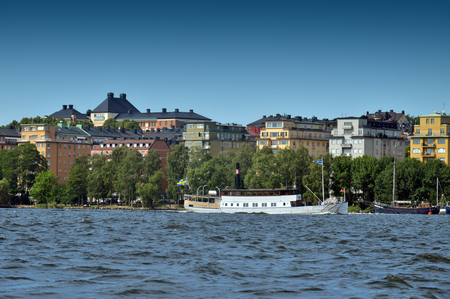 Waterside settlement full of iconic buildings at port of Kungsholmstorg brygga in Stockholm, Sweden Stock Photo