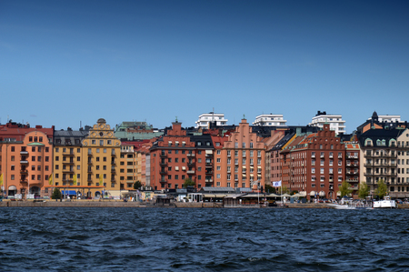 Waterside settlement full of iconic buildings at port of Kungsholmstorg brygga in Stockholm, Sweden Editorial