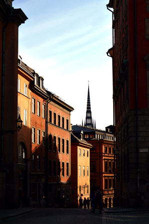 Light and shadow reflects on historic buildings in Gamla Stan, the old town of Stockholm, Sweden