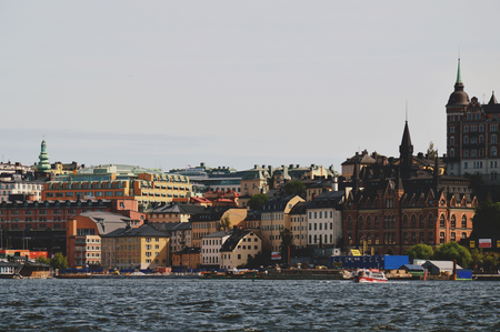 Cityscape view of Stockholm's old town in famous Gamla Stan area densely situated by archaic buildings influenced by North German architecture