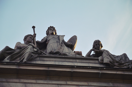 Details of art and decor on Building of The Parliament House of Sweden built in Neoclassical style, with a centered Baroque Revival style facade section, located on nearly half of Helgeandsholmen island, in the Gamla stan, old town district of central Stockholm