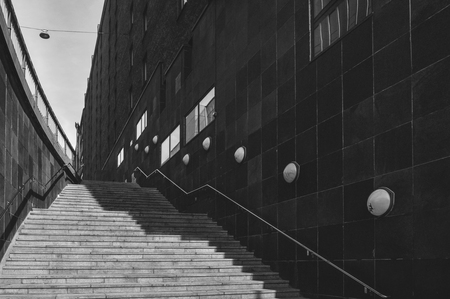 A stairway in the city of Stockholm, Sweden, in black and white with artistic low-key light and shadow Banco de Imagens