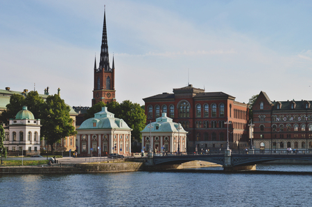 Cityscape view of Stockholm�s old town in famous Gamla Stan area densely situated by archaic buildings influenced by North German architecture Stock Photo - 101239728