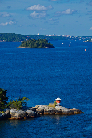 Lighthouse located on islet of Stockholm Archipelago in Baltic Sea, Sweden Stock Photo