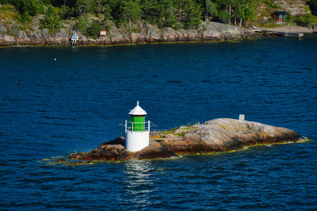 Lighthouse located on islet of Stockholm Archipelago in Baltic Sea, Sweden Stock Photo - 101228284