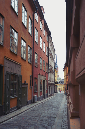 Stockholm, Sweden - July 2014: Old town of Stockholm in Gamla Stan with historic buildings along narrow cobble street