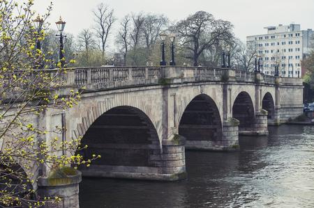 Kingston upon Thames, United Kingdom - April 2018: Kingston Bridge carrying the A308 Horse Fair Road across the River Thames in Kingston, England