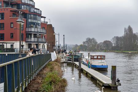 Kingston upon Thames, United Kingdom - April 2018: Riverside Walk promenade by the River Thames in Kingston, England