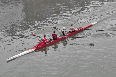 Kingston upon Thames, United Kingdom - April 2018: Oarsmen from Kingston Rowing Club training for canoe boat race in the River Thames, Kingston, England