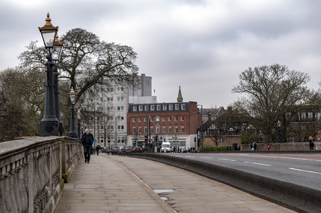 Kingston upon Thames, United Kingdom - April 2018: Kingston Bridge carrying the A308 Horse Fair Road across the River Thames in Kingston, England Editorial