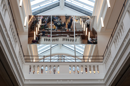 London, UK – April 2018: The big mirror reflecting new members room located on the top floor of Aston Webbs Grade 1 Listed 1909 wing of Victoria and Albert Museum serving food and beverage from all-day menu