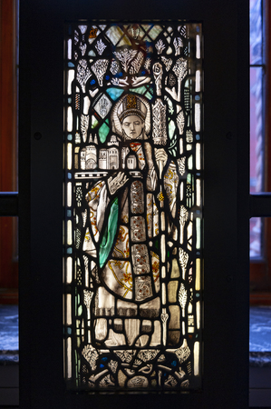 London, UK – April 2018: Panels of stained and painted glass exhibited at Sacred Silver and Stained Glass room at the Whiteley Gallery in Victoria and Albert Museum