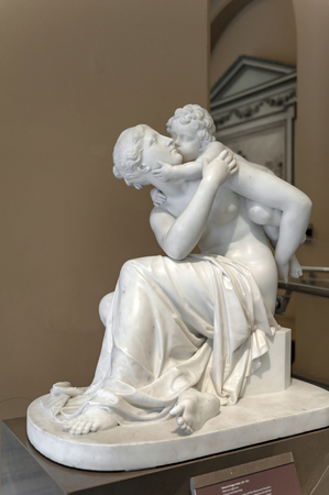 London, UK – April 2018: Marble sculpture titled Maternal Affection by Edward Hodges Baily exhibited at the Dorothy and Michael Hintze Galleries in Victoria and Albert Museum