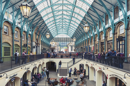 London, UK - April 2018: Interior of Covent Garden Market, a place for fashionable retail stores and dining on popular tourist site surrounded by historical buildings, theatres and entertainment facilities in Westminster City, Greater London Sajtókép