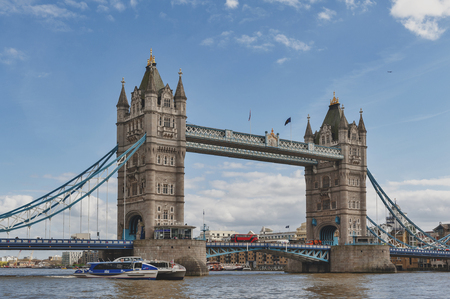 London, UK - April 2018: Tower Bridge, a combined bascule and suspension bridge with twin towers crossing the River Thames which becomes an iconic landmark and major tourist attraction of London, England