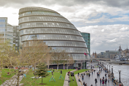 London, UK - April 2018: The curved glass building in spherical shape of the City Hall of London, an iconic architectural landmark of London, located on the Southwark bank of the River Thames near Tower Bridge in London, England
