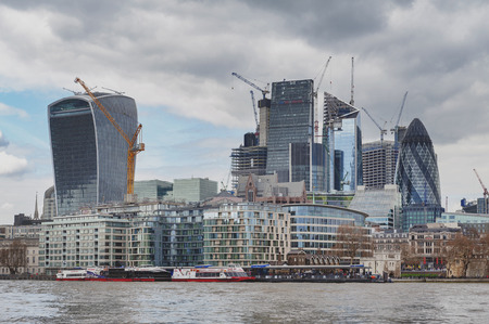 London, UK - April 2018: Skyline of the city of London by the River Thames with skyscrapers and buildings constructed in modern architectural style