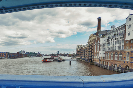 London, UK - April 2018: The River Thames and Butlers Wharf Pier seen from the Tower Bridge of London, England