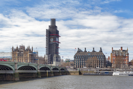 London, UK - April 2018: The Elizabeth Tower, the Great Clock and the Great Bell, known as Big Ben, the iconic landmark of London, and the Palace of Westminster being scaffolded during the significant renovation since early 2017