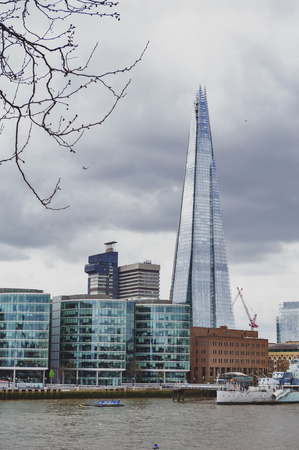 London, UK - April 2018: The Shard, tallest building in UK, iconic architectural landmarks of London located on the Southwark bank of the River Thames in London, England Editorial