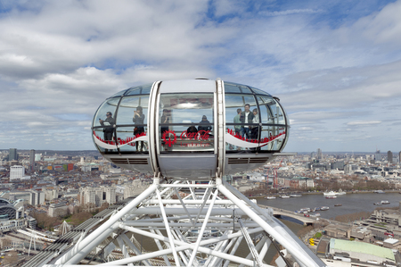 London, UK - April 2018: The ovoidal passenger capsule of the London Eye, a popular giant Ferris wheel, iconic landmark of London, located on the South Bank of River Thames in London, England Editorial