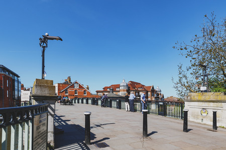 Berkshire, UK - April 2018: The Windsor Bridge or Windsor Town Bridge, an iron and granite arch bridge over the River Thames located between the towns of Windsor and Eton in Berkshire