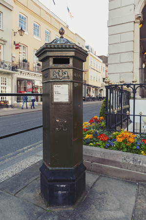 Windsor, UK - April 2018: Early UK pillar box, a free-standing post box to be collected by the Royal Mail of United Kingdom, situated on High Street of Windsor, Berkshire, England