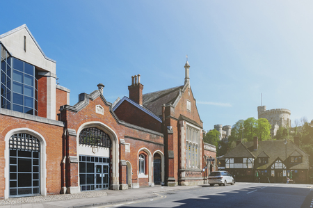 Berkshire, UK - April 2018: Historic building of Windsor & Eton Riverside Station, the railway terminus of the Staines to Windsor Line, served by South Western Railway, located on Farm Yard Street with proximity of Windsor Castle Editorial