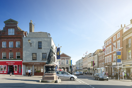 Windsor, UK - April 2018: Queen Victoria Statue on Castle Hill Street and High Street next to Windsor Castle in the town of Windsor, Berkshire, England