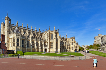 Windsor, UK - April 2018: St George Chapel built in high-medieval Gothic architectural style, at Windsor Castle, royal residence at Windsor in county of Berkshire, England, UK
