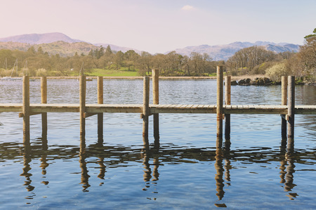 Waterhead Pier at Ambleside, a lakeside town situated at the head of Windermere Lake within the Lake District National Park in South Lakeland, England Stock Photo