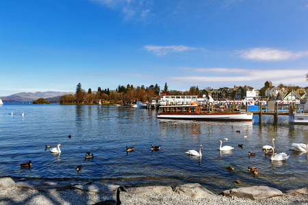 South Lakeland, UK - April 2018: Bowness Pier with boats for hire and tourist cruises at Bowness-on-Windermere, a small tourist resort town on the banks of Windermere in Lake District, England Redakční