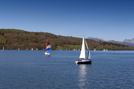 South Lakeland, UK - April 2018: Sailboats racing at a regatta event on Lake Windermere in the Lake District National Park, North West England, UK Editorial