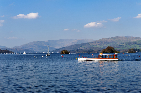 South Lakeland, UK - April 2018: Scenic lake cruise by a vintage wooden boat on Lake Windermere in Lake District National Park, North West England, UK
