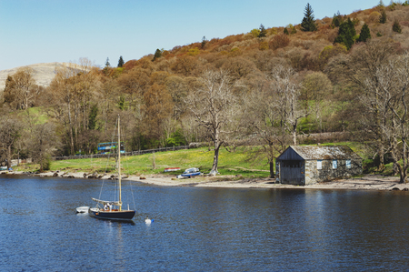 South Lakeland, UK - April 2018: Sailboat anchoring at Lake Windermere in the Lake District National Park, North West England, UK Editorial