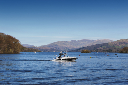 South Lakeland, UK - April 2018: Scenic lake cruise by a motorboat on Lake Windermere in Lake District National Park, North West England, UK Editorial