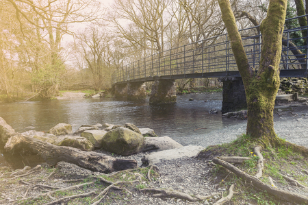 Bridge over River Rothay at White Moss Walks, scenic forest recreational area in Ambleside, Lake District National Park in South Lakeland, England, UK
