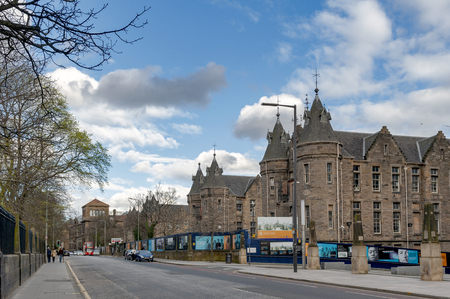 Edinburgh, Scotland - April 2018: Historic Scottish Baronial style buildings of the former Royal Infirmary of Edinburgh that was used as Old Surgical Hospital, now being restored by Quartermile Development for University of Edinburgh, Scotland, UK