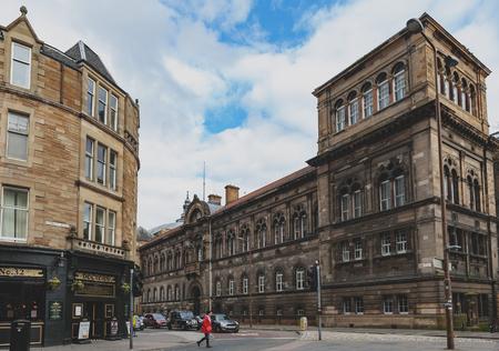 Edinburgh, Scotland - April 2018: Building exterior of The University of Edinburgh at the corner of Forrest Road and Teviot Place in city center of Edinburgh, UK Editorial