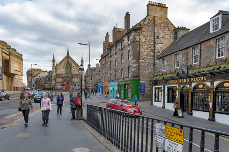 Edinburgh, Scotland - April 2018: View of George IV Bridge, elevated street with historic buildings towards Bedlam Theatre housed in former Neo-gothic church in city center of Edinburgh, Scotland, UK Editorial