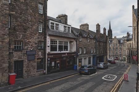 Edinburgh, Scotland - April 2018: View from George IV Bridge towards Candlemaker Row Street alongside with historic buildings in city center of Edinburgh, Scotland, UK