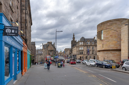 Edinburgh, Scotland - April 2018: Historic buildings alongside of George IV Bridge, elevated street with view towards Royal Mile and coppered-dome of Bank of Scotland headquarters, in city center of Edinburgh, Scotland, UK