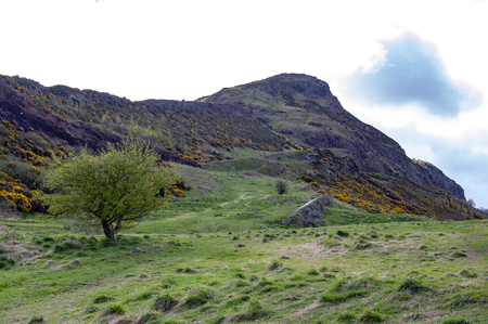 A hillwalking route through grassy slopes up to Arthur's Seat, the highest point in Edinburgh located at Holyrood Park, Scotland, UK