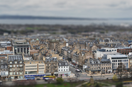 Cityscape of old town Edinburgh with classic Scottish buildings on Princess Street towards North Sea as seen from the Esplanade of Edinburgh Castle