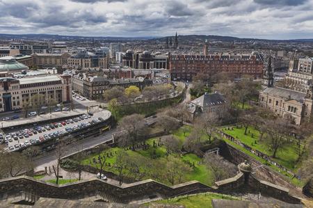 Edinburgh, Scotland - April 2018: Cityscape of old town Edinburgh from Princess Street Gardens towards the Parish Church of Saint Cuthbert, Saint Johns Episcopal Church, and University of Edinburgh