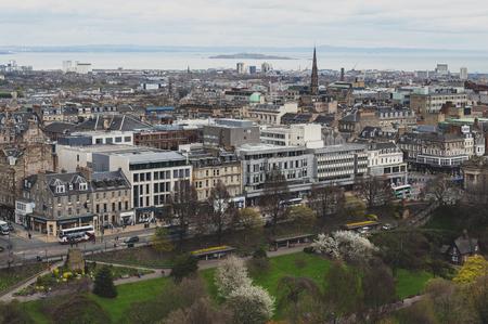Edinburgh, Scotland - April 2018: Cityscape of old town Edinburgh with classic Scottish buildings on Princess Street towards North Sea as seen from the Esplanade of Edinburgh Castle