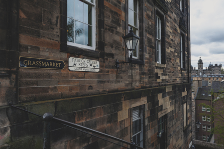 Patrick Gedges Steps and Grassmarket signages on a building wall in Old Town Edinburgh, Scotland