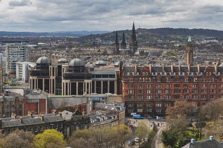 Edinburgh, Scotland - April 2018: Cityscape of old town Edinburgh from Princess Street Gardens towards the University of Edinburgh, Charlotte Chapel, and Saint Mary Cathedral Editorial